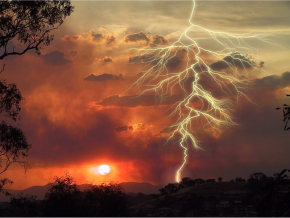 lightening over the sun